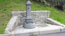 Ein Brunnen spendet frisches Trinkwasser am Stellplatz Maccagno