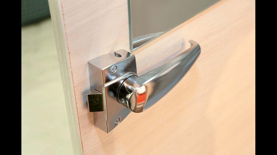 Einfaches, innen auf die Tür aufgesetztes Toilettenraumschloss