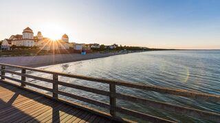 Germany, Mecklenburg-West Pomerania, Rugen Island, Binz, Ostseebad, Pier and sea at sunset, Rügen