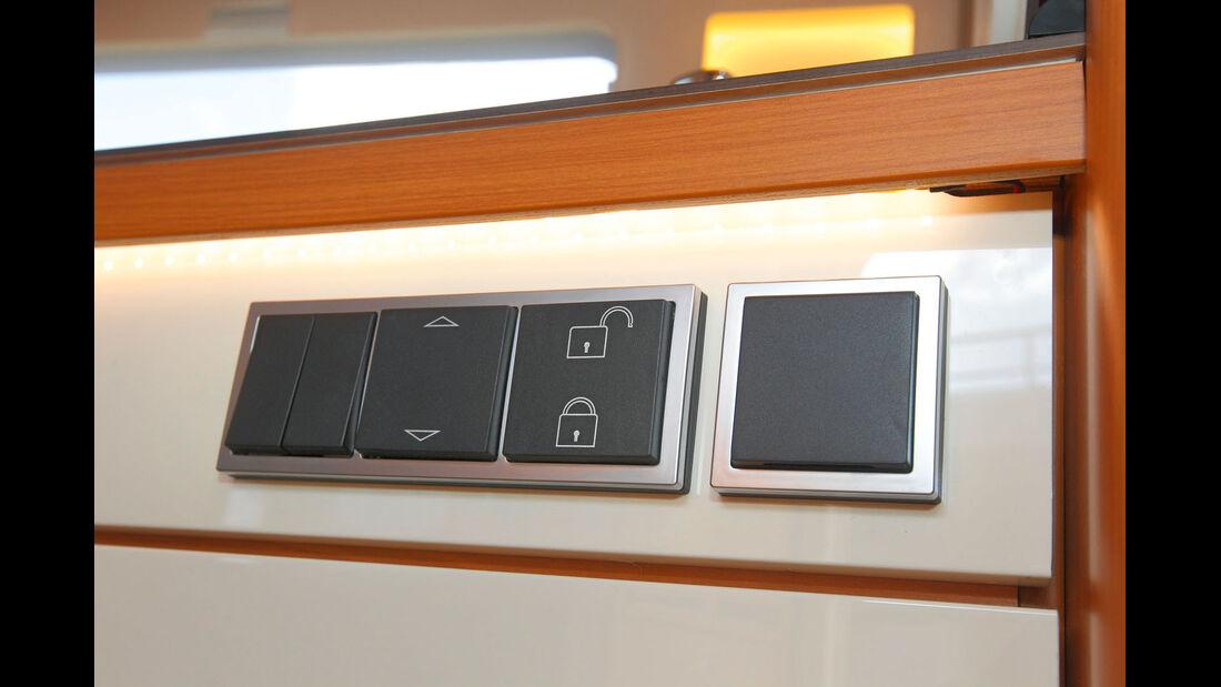 Kuechenschubladen lassen sich auf Knopfdruck elektrisch verriegeln.