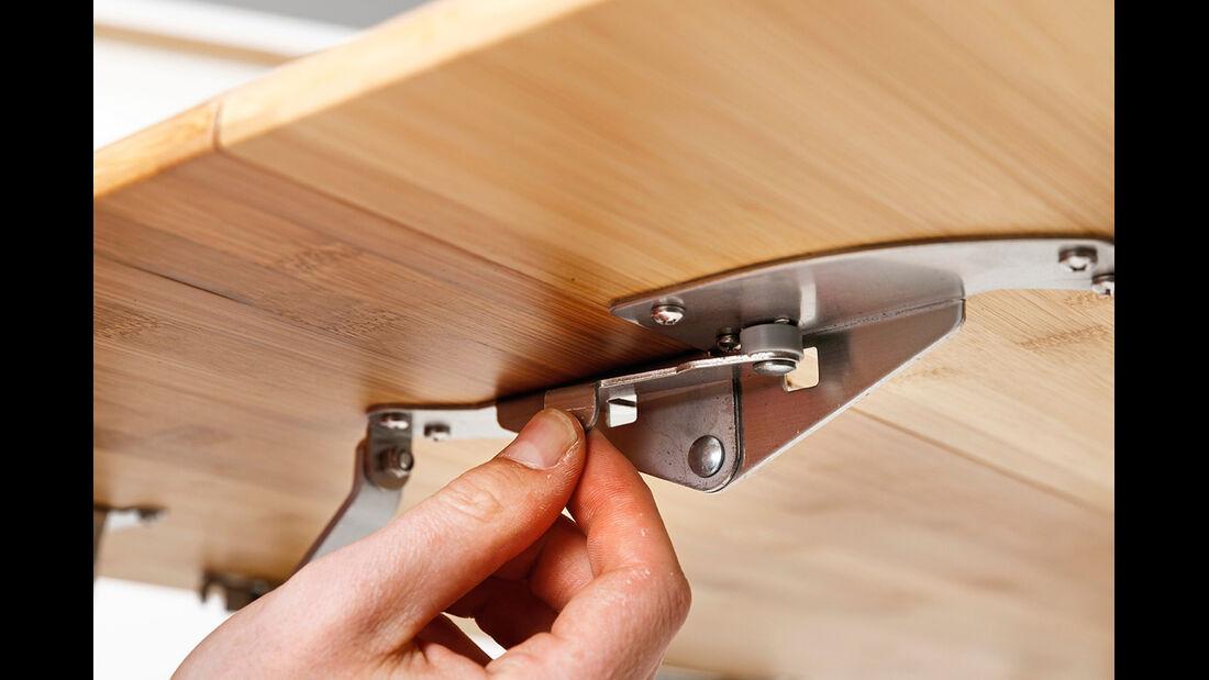 Metallhebel verhindern ungewolltes Aufklappen.