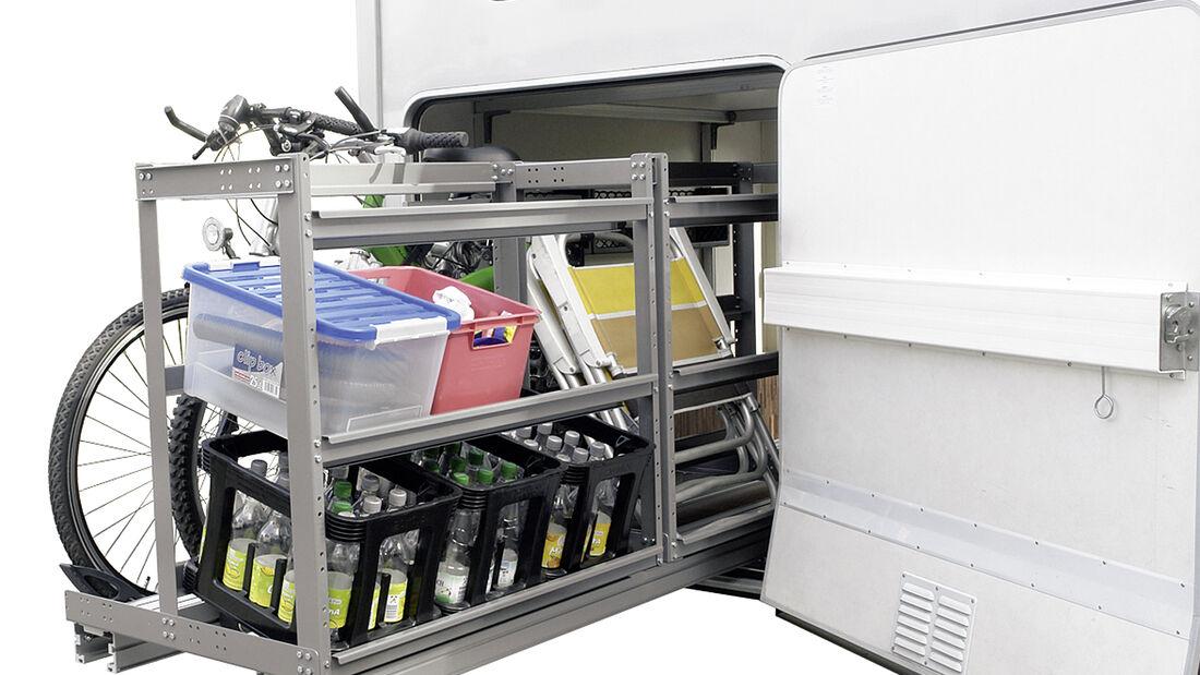 Moveras Load-Move ist ein von beiden Fahrzeugseiten ausziehbares Regal-System für die Heckgarage.
