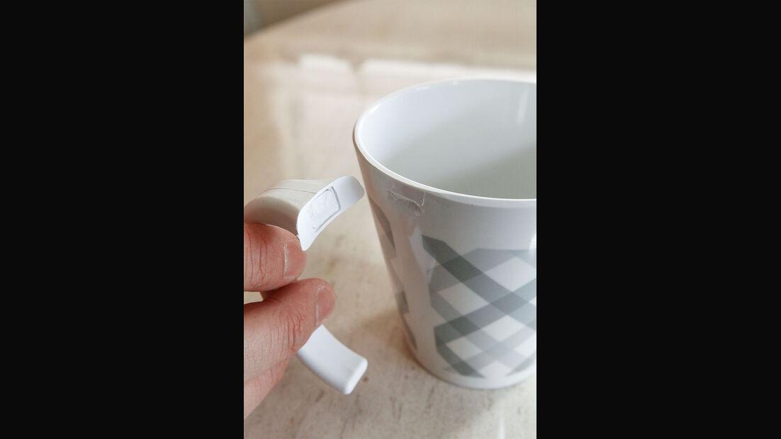 Tasse mit abgebrochenem Henkel