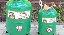 Wynen-Gas verkauft die grünen Metall- Tankflaschen.